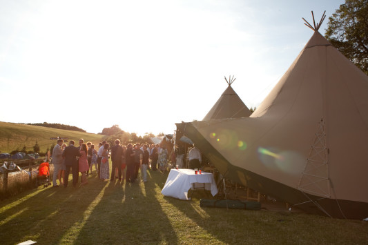 25th July 2015. Stephanie and Steve get married at Hadsham Farm in Banbury, Oxfordshire. Their wedding has a Glastonbury Festival theme and guests are camping on-site for the weekend.