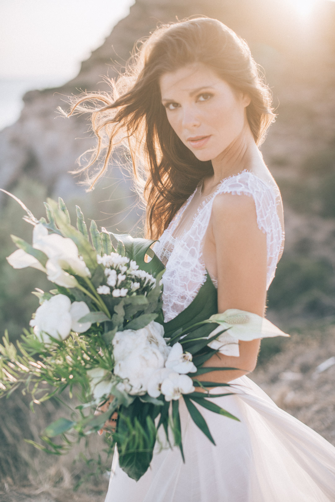 large-white-flower-bouquet-and-bohemian-lace-wedding-dress