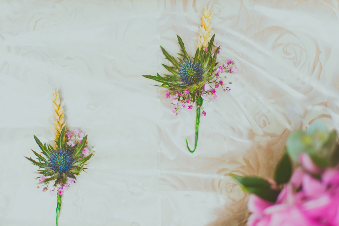 bright-wild-flower-pins-vicky-and-james-festival-wedding