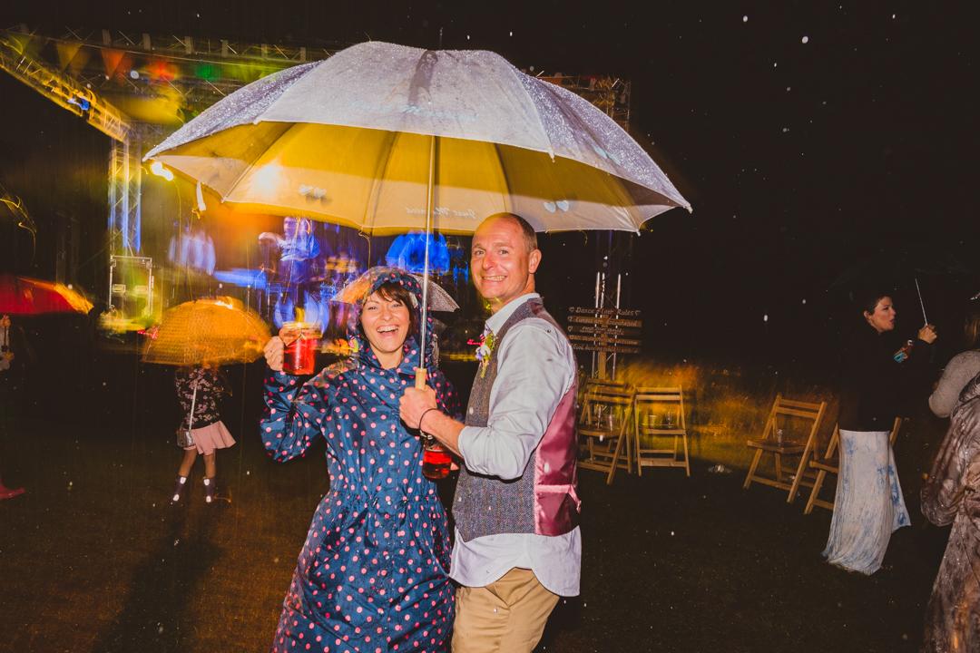 umbrella-jen-and-mat's-festival-wedding-at-Scraptoft farm