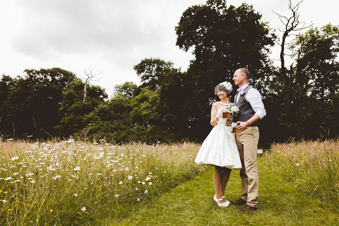 bride-and-groom-jen-and-mat's-festival-wedding-at-Scraptoft farm