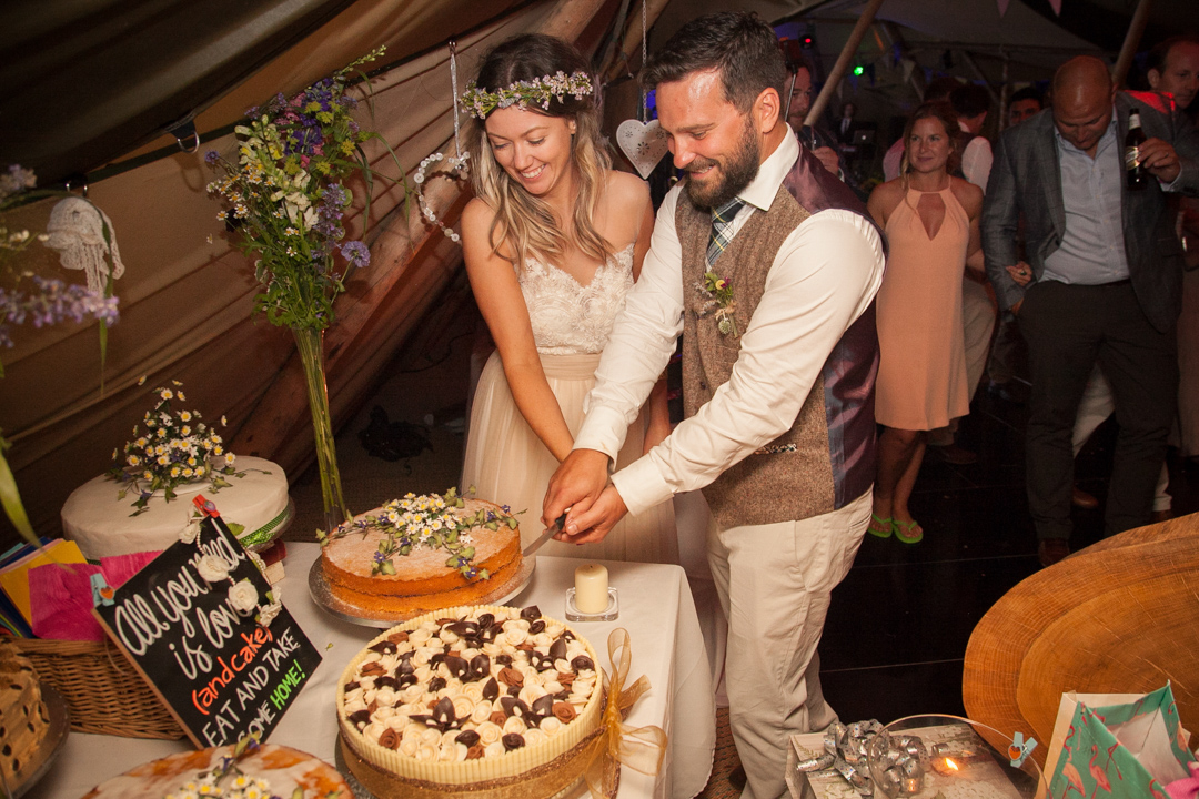 cutting-the-cake-sara-and-tims-festival-tipi-wedding