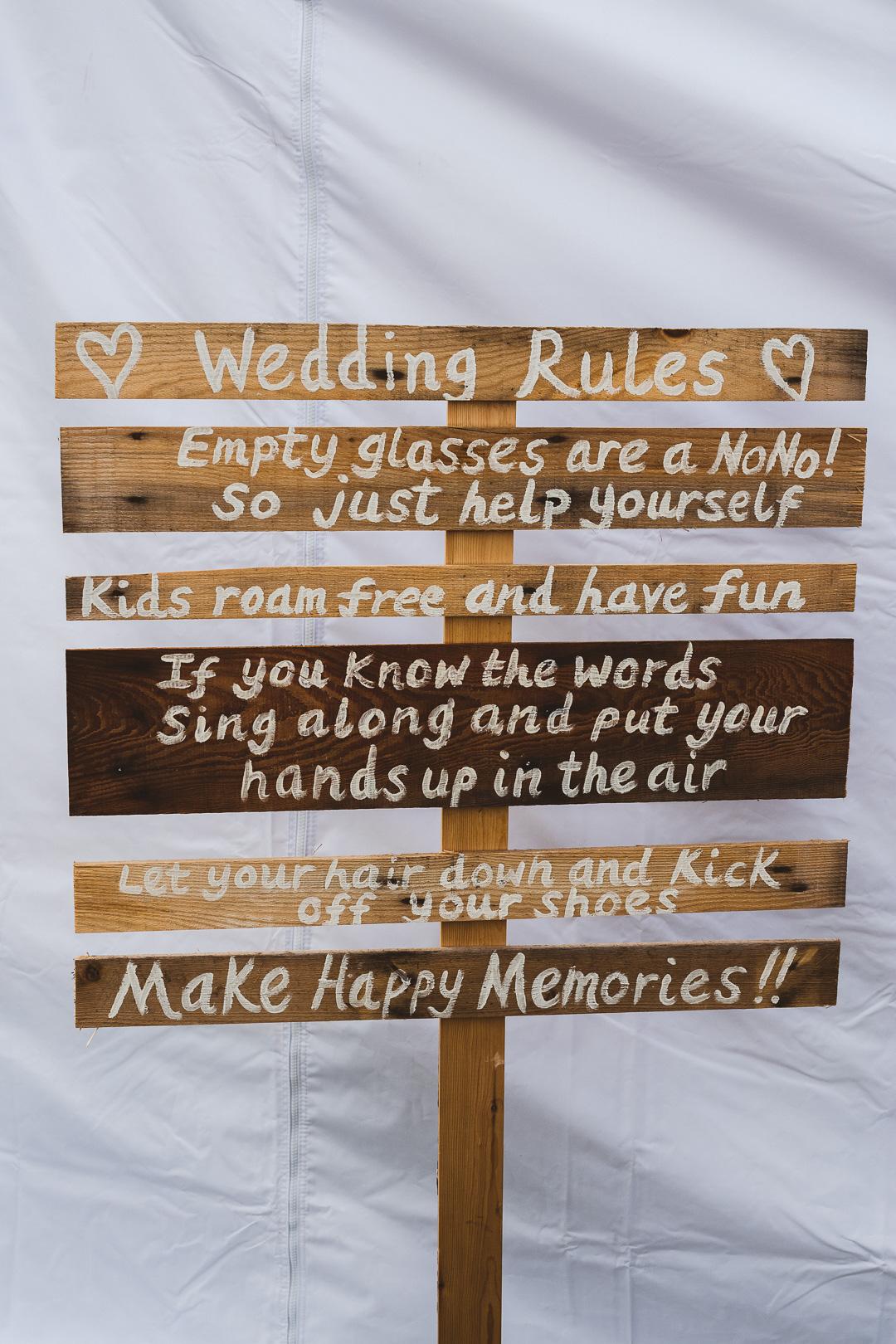 DIY-wooden-signs-jen-and-mat's-festival-wedding-at-Scraptoft farm
